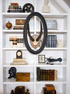 Transform bland bookcases and wall shelves into stunning displays with 18 top-shelf decorating tips from interior designers.