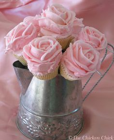 Yummy bouquet! Love the idea of a centerpiece that you can eat! Decorations AND favors at a wedding! How fun!  DIY: Cupcake Bouquet Tutorial...has Wilton Buttercream Recipe and she gives a link to a video tutorial on how to frost the cupcakes, this is so pretty!
