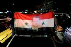Syria's government forces killing civilians in eastern Aleppo, says UN:     Aleppo:    Supporters of Syria's President Bashar al-Assad carry a Syrian national flag with his picture as they celebrate what they say is the Syrian army's victory against the rebels in Aleppo.   Omar Sanadiki/Reuters