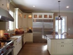 glazed kitchen cabinets vs white | ... Kitchens - Image: Refrigerator Cabinet with Glass Cabinets and