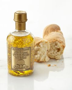 Fernando Pensato White Truffle Olive Oil with Gold Flakes      EXCLUSIVELY OURS.     Extra-virgin olive oil made from Peranzana olives and white truffle oil.     Cold pressed in traditional granite mills.     Infused with 18-kt. gold flakes.     8.45 ounces.     Made in Italy.