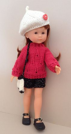 This cute little Paris inspired set matches the 18inch doll pattern which is also in my ravelry store. There are black sparkly shorts, a back fastening sweater with Eiffel Tower stitch pattern,a cute beret and a shoulder bag.