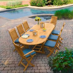 My dream patio furniture, with self storing extension!    Harborside Teak Extension Dining Table - Country Casual