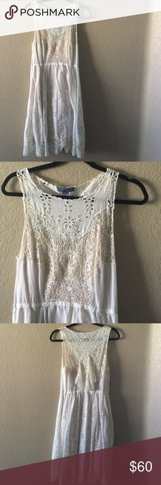 """anthropologie white eyelet dress worn once with no visible flaws. includes cream colored slip. 40"""" long, 17"""" across bust. marked as an 8 but could easily fit a 6. Anthropologie Dresses"""