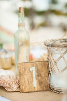 rustic, hand-painted table numbers