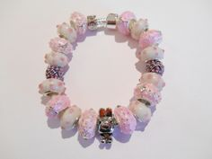 Lampwork Glass Beads w Silver/Pearl Spacers; Silver/Enamel Spacers and Pugster® Bunny Charm http://www.etsy.com/shop/CharmedByCarol http://stores.shop.ebay.com/charmedbycarol Direct email: carol-soto@att.net