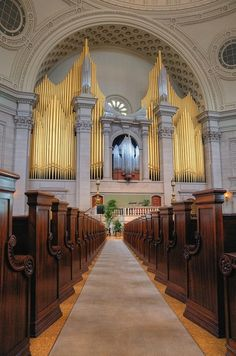 Pipe Organ of the First Church of Christ, Scientist, Boston MA, 1952, photo by jcbwalsh, via Flickr.  A large number of the exposed pipes have been painted gold while others are left silver.  The effect is striking, set in a lovely stonework recess.  (The dark wood pews are lovely, too.)