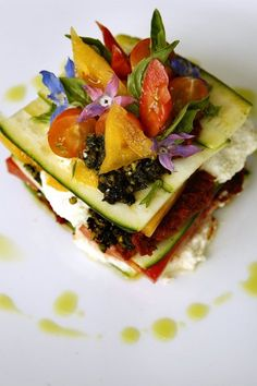 A market tomato lasagna made with zucchini, macadamia, Santa Barbara pistachio and basil served at chef Matthew Kenneys raw vegan restaurant M.A.K.E. in Santa Monica.
