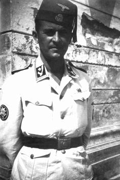 SS-Hauptscharführer Kurt Stegemann from the German cadre of the Handschar Division. This view shows the fez and its regulation machine-woven insignia as well the special collar patch to good advantage. Note also the Edelweiss on the right sleeve patch. He was in the signal battalion of the division.