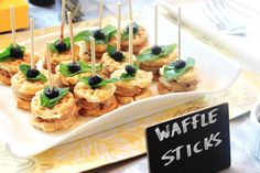 Waffle Sticks. Just skewer 3 mini waffles with a mint leaf and piece of fruit.