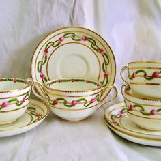 George Jones & Sons Crescent Porcelain Double Handle Cream Soups w Underplates Set of Four Rose Swag Pattern