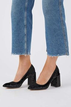 The flared heel is this season's must-have shoe style. A chunky mid-heel, these high court shoes come in a chic black. #Topshop