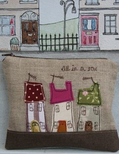 Coin purse with little applique houses 'All In A Row'.