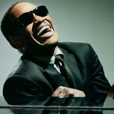 Jamie Foxx as Ray Charles in Ray | 23 Incredible Photos Of Actors Vs The Historical Figures They Played