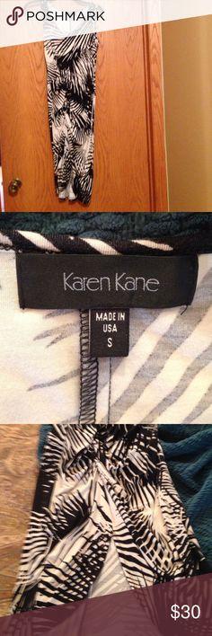 Flattering Karen Kane summer dress. Black & cream Palm print.  Ruched down the center from waist to tulip hem. Karen Kane Dresses
