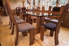 Dining set by martin@thankU.ca  Modern furniture in rustic timber frame barn  Walnut and glass w wool upholstery