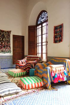 """Textile designer, sourcing consultant and founder of Artisan Project, Nina M. Alami lives in a patterned, colorful riad in the Old Medina of Fes with her husband, Mohamed and their kids. The mother of four, she's also an """"artist producing textiles with a community of cooperatives, and a lineage of craftsman; simultaneously sourcing, consulting, and overseeing production in Fes, the Middle Atlas and the Rif regions of Morocco."""""""