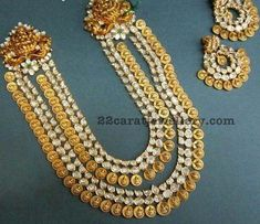 Two layers pachi long chain with 22 carat gold round Lakshmi coins. Two tone rows attached with antique work Lakshmi motifs embossed on t...