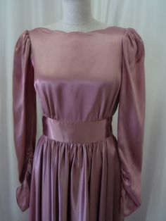 You can see this dress at our Etsy store: https://www.etsy.com/ca/listing/182164474/1940s-style-pierre-de-roche-charmeuse?ref=shop_home_active_9