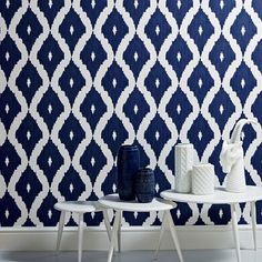 A contemporary take on the Ikat design trend in blue and white is inspired by Kelly's love of Asian design culture and traditional fabric designs. This geometric wallpaper design co ordinates with the Linen Texture semi plain and features shimmering highlights mixed with a matte fabric effect Ikat pattern that would add a real impact to your home or even workspace.