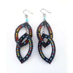 Wonderful shape and colors in these beaded earrings, Black Fire Raindrops by TSOul (Navajo)