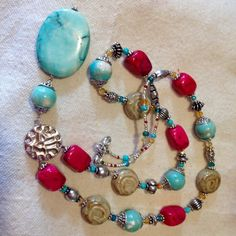 This gorgeous Turquoise, Coral, Ceramic and Silver Beaded Pendant Necklace was hand made and custom designed by myself. It measures 28 inches in
