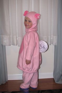 Piggy bank costume! Just get a pig costume, sew black velcro on the back for the bank's slot and create a coin out of a styrofoam disc! Velcro the disc to the kid's back. Awesome and easy!
