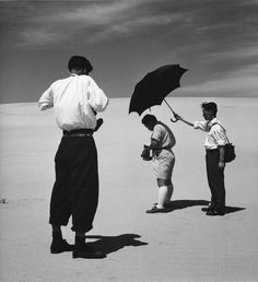Shoji Ueda taking picture of Ken Domon on the dunes, 1950. photo by Yoichi Midorikawa