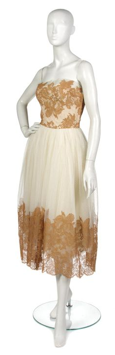 A Lanvin Castillo Lace Cocktail Dress,  1950s,  strapless copper lace bodice and trim, cream Swiss dot full skirt.