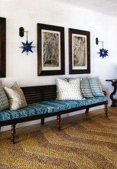 bench, star lanterns, batik cushions.   a herringbone pebble 'runner'...