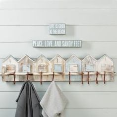 Beach House Wall Rack Choose which beach house beckons, and hang out! 10 hooks across a clever row of delightfully weather-worn mango wood beach houses, aged for delightful effect. No assembly required. Beach Wall Decor, Beach Cottage Decor, Coastal Decor, Cottage Ideas, Diy Cabin, Home Decor Catalogs, Beach Cottages, Beach Houses, Tiny Cottages