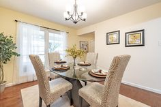 This gorgeous dining room is in the perfect home for a young family in Chesterfield, Missouri. Home Staging Companies, Dining Room, Dining Table, Young Family, Furniture, Home Decor, Decoration Home, Room Decor