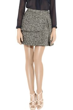 Carven skirt: black and white wool-blend tweed, fitted waistband, asymmetric pleat, curved panel, concealed side pocket, fully lined. Concealed zip and hook fastenings at lunch. Fabric1: 37% wool, 26% nylon, 22% acrylic, 15% silk; fabric2: 100% wool; lining: 60% viscose, 40% acetate. Dry clean.