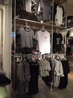 This display was found inside a Brandy Melville store in Soho. The brand stuff to a dull color palette by only using whites, greys, and blacks, but it is part of their story. A lot of the store's clothing is comprised of those colors, opposite of what one would find in a Kate Spade store. The display uses a grid system 3x3 but effectively switches the shirts to the side on the bottom rack. The steel poles come off as a basic and minimalist style that resembles the entire clothing/store.