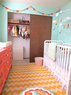 Love the wall color and the yellow rug, maybe too girly?
