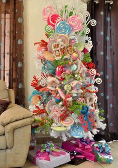 In this DIY tutorial, we will show you how to make Christmas decorations for your home. You will learn how to. Harry Potter Christmas Decorations, Retro Christmas Decorations, Creative Christmas Trees, Christmas Trees For Kids, Whimsical Christmas, Colorful Christmas Tree, Christmas Tree Themes, Gingerbread Christmas Decor, Candy Land Christmas