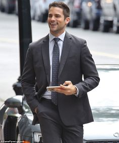Handsome and a sharp dresser: Their co-star, Brant Daugherty, who plays Sawyer - was also on hand during filming, dressed in a suit and tie