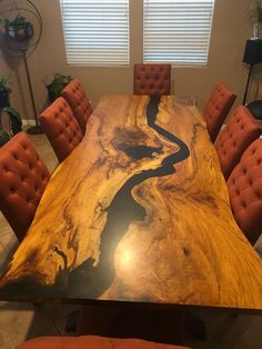 Live Edge Pecan Dining table with black epoxy filled river and a black power coat Base. This particular table is 9ft but all tables can be customized to your size. *shipping is determined by location