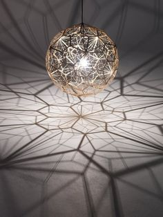 Tom Dixon pendant lamp that projects beautiful shadows as it illuminates a space. See more of his work at http://www.tomdixon.net/