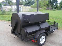 Trailer BBQ smoker grill with a rotisserie.
