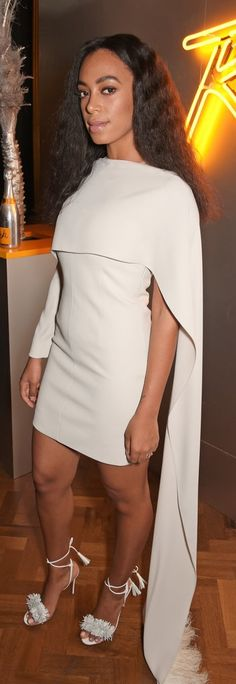 Solange Knowles kept to her now-signature style at the Veuve Clicquot Rich launch in a white Marios Schwab dress that included a cape.
