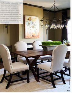 Love the linen chairs with nail-head trim and the iron and glass hanging lights. Love love love!