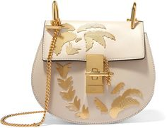 Chloé - Drew Embellished Leather Shoulder Bag - Ivory For Resort '17, Chloe's Creative Director Clare Waight Keller looks to the shores of Los Angeles for inspiration. This cult-favorite 'Drew' bag is reworked in soft ivory leather and finished with polished gold palm tree embellishments. Carry yours cross-body against a floaty blouse and jeans.