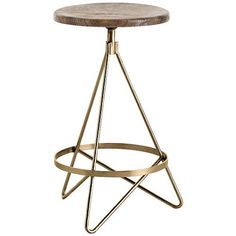 A natural wax swivel back counter stool featuring a vintage brass and distressed wax finish. Bring chic style and artistic design to the lounge or bar with this gorgeous antique brass finished backless swivel counter stool with a natural wax finished wood seat.