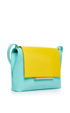 "Known for his whimsical demi-couture, for Spring 2015 designer Josep Font delivers pieces for a ""modern yet passionate"" woman. This **Delpozo** bag features bright contrasting hues to add a pop of color to any outfit."