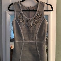 EUC, insanely gorgeous silver beaded bodycon dress EUC, insanely gorgeous silver beaded bodycon dress, only worn once. This dress is simply stunning, and fits like a gem! I sadly have no need for it anymore. WOW couture Dresses