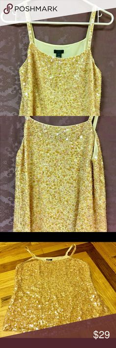 "J.Crew gold & pink sequin top Silk tank with spaghetti straps by J.Crew covered in gold, pink and iridescent . Very swingy and great for a night out. 💁🏼 The outer shell is 100% Silk. The lining is 100% Polyester.  Hidden zipper up one side. Approximate measurements lying flat: Armpit to armpit- 18""  Length from top of strap to bottom hem- 24"" J. Crew Tops Tank Tops"