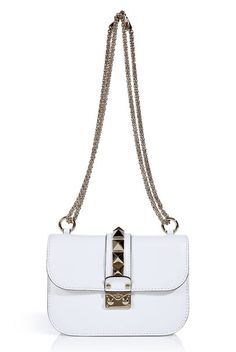 This Valentino Rock Stud bag is the perfect white bag to wear with your party ensembles this summer.