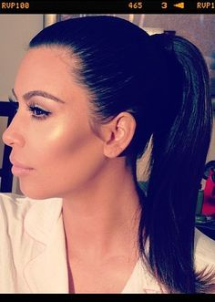 Kim Kardashian's contoured cheeks and sleek ponytail