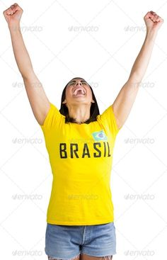 Excited football fan in brasil tshirt on white background ...  20s, Studio Shot, attractive, beautiful, brasil, cheerful, cheering, cup, cut out, energy, euphoria, event, excited, excitement, fan, female, football, goal, green, happy, isolated, joy, mixed-race, pretty, shouting, smiling, soccer, spectator, sport, supporter, t-shirt, victory, wearing, white background, winning, woman, world, yelling, yellow, young adult